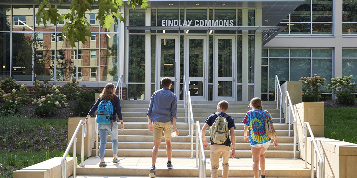 students outside entrance of findlay commons