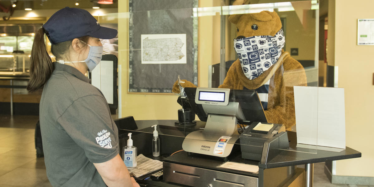 Nittany Lion swiping id+ card at the cash register in the dining commons. Photo credit: Patrick Mansell